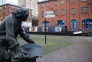 Debdale moored in Coventry Basin by the statue of James Brindley.